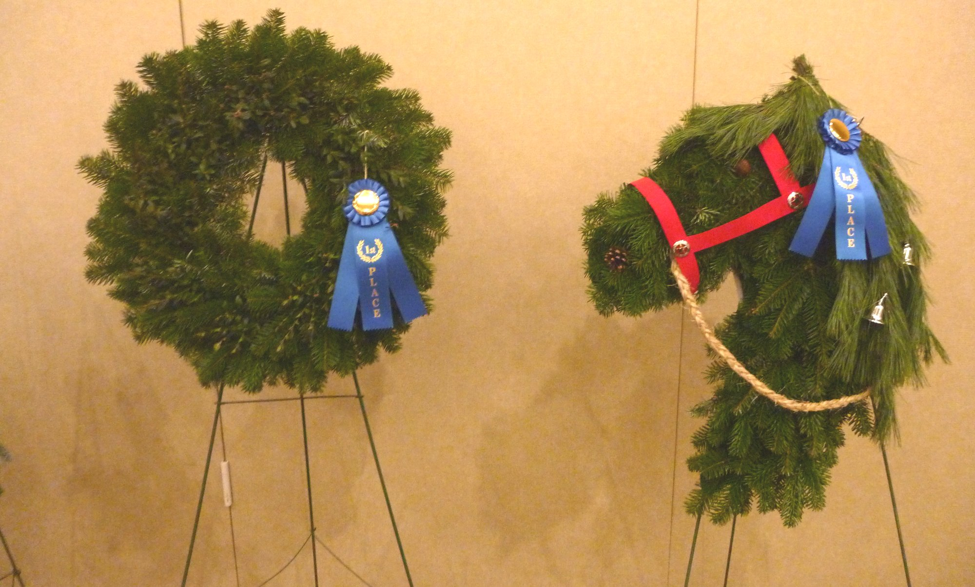 First place undecorated wreath and first place decorated greenery.